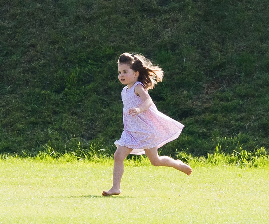 "It looks like this princess is not afraid to get her hands (or feet) dirty, spotted running around barefoot and [doing headstands during a day out](https://www.nowtolove.co.nz/celebrity/royals/princess-charlotte-does-a-headstand-38078|target=""_blank"") with her mum and older brother in June 2018. *(Image: Getty)*"