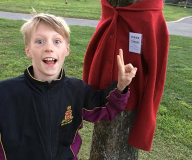Why we're all enchanted by the 10-year-old boy leaving warm coats on trees
