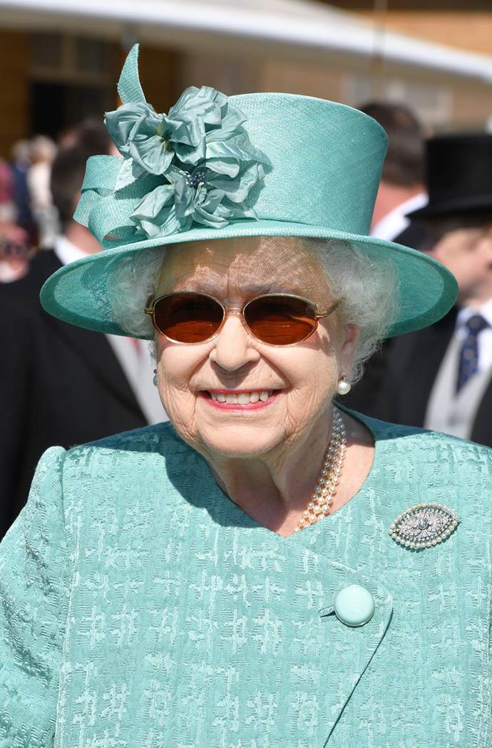 Always prepared, the Queen teamed her sunglasses with an umbrella - because you never know how the London weather will turn out for a Buckingham Palace garden party!