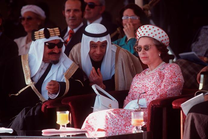 Cool as a cucumber, the Queen kicks back and chillaxes as she watches a dancing display in Kuwait with Sheikh Abdullah Jabir.