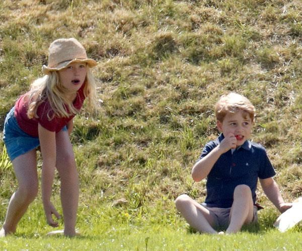 You can't sit with us! Savannah Phillips pushes Prince George down a hill