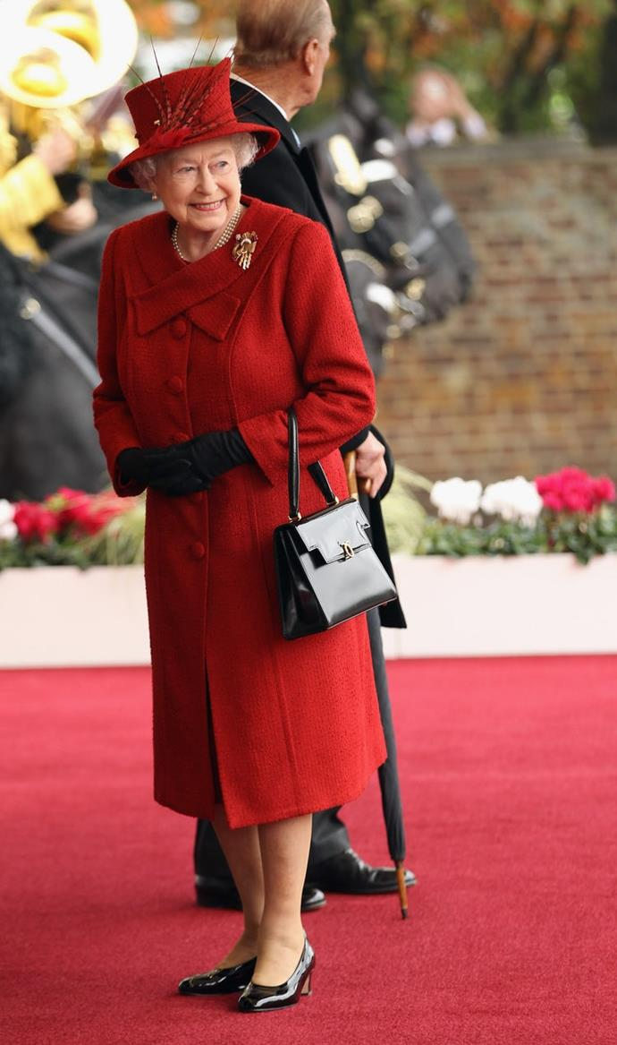The Queen looked glamorous in bold red while visiting Windsor Castle back in 2010.