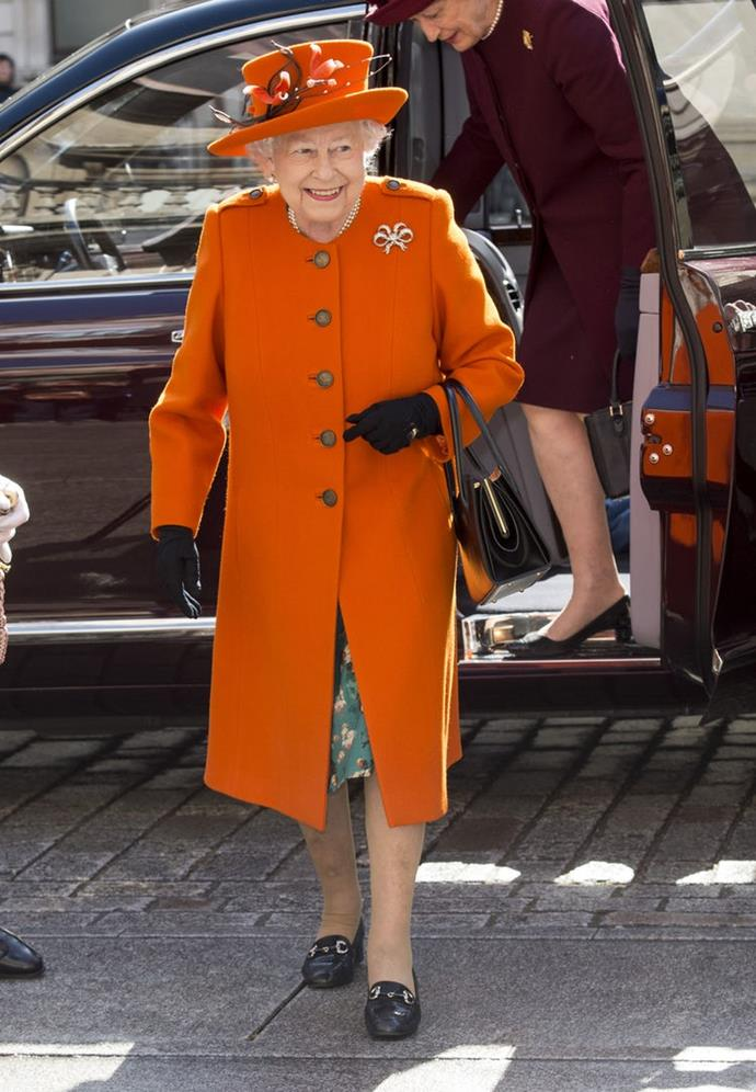 Bright orange was the colorful hue Queen Elizabeth chose for a London outing in March 2018.