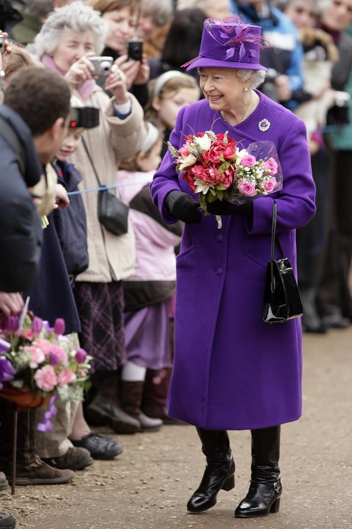 The Queen rocked this bright purple look for a February 2011 royal outing.