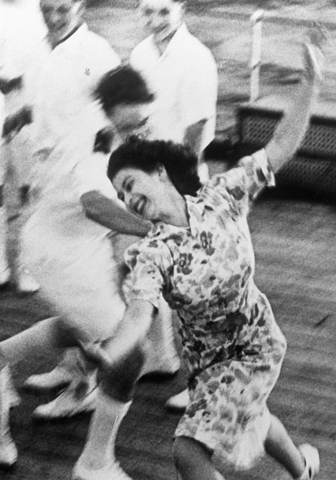 This joyful image of the Queen running free-spirited on the deck of a ship was taken in 1947 - she was playing tag with the midshipmen on board the HMS Vanguardin.
