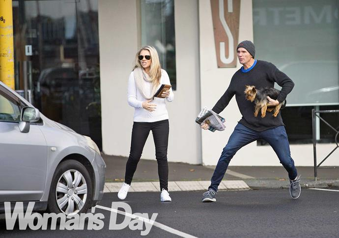 Clutching his ferocious guard dog for reinforcement, our hero leaps to the defence of his lovely lady as she steps into the street.