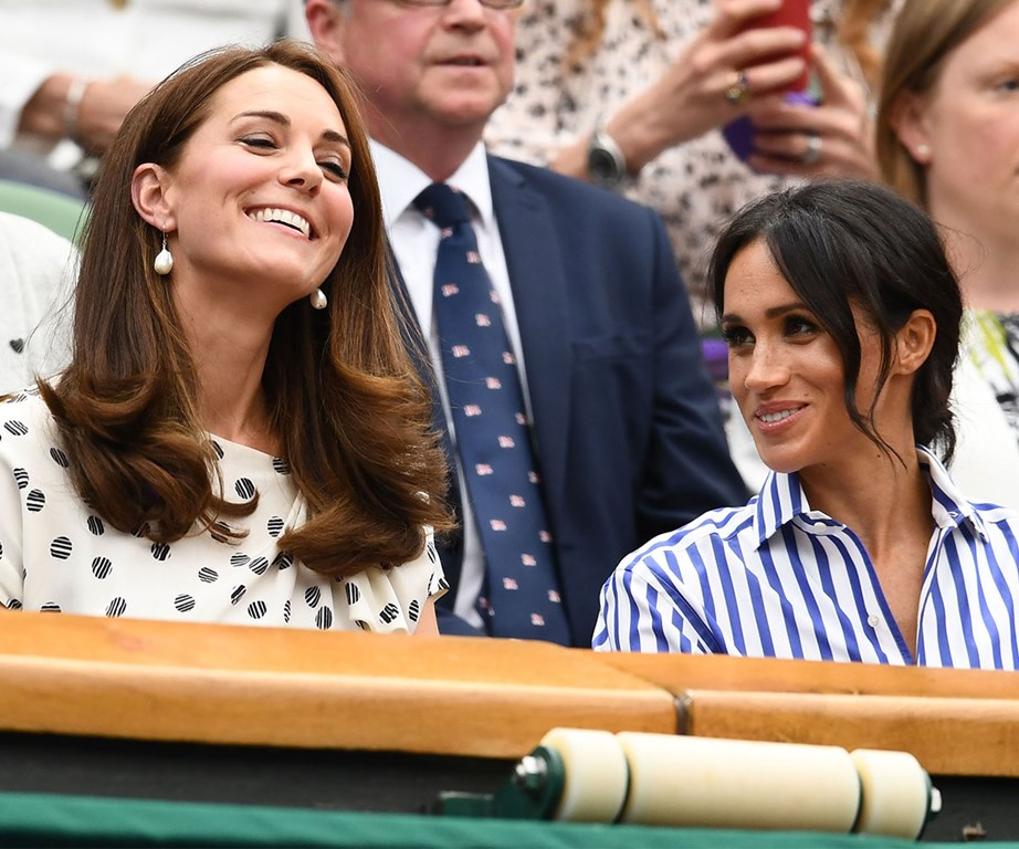 Meghan and Kate made their first joint appearance at last year's Wimbledon to watch the final. *(Image: Getty)*