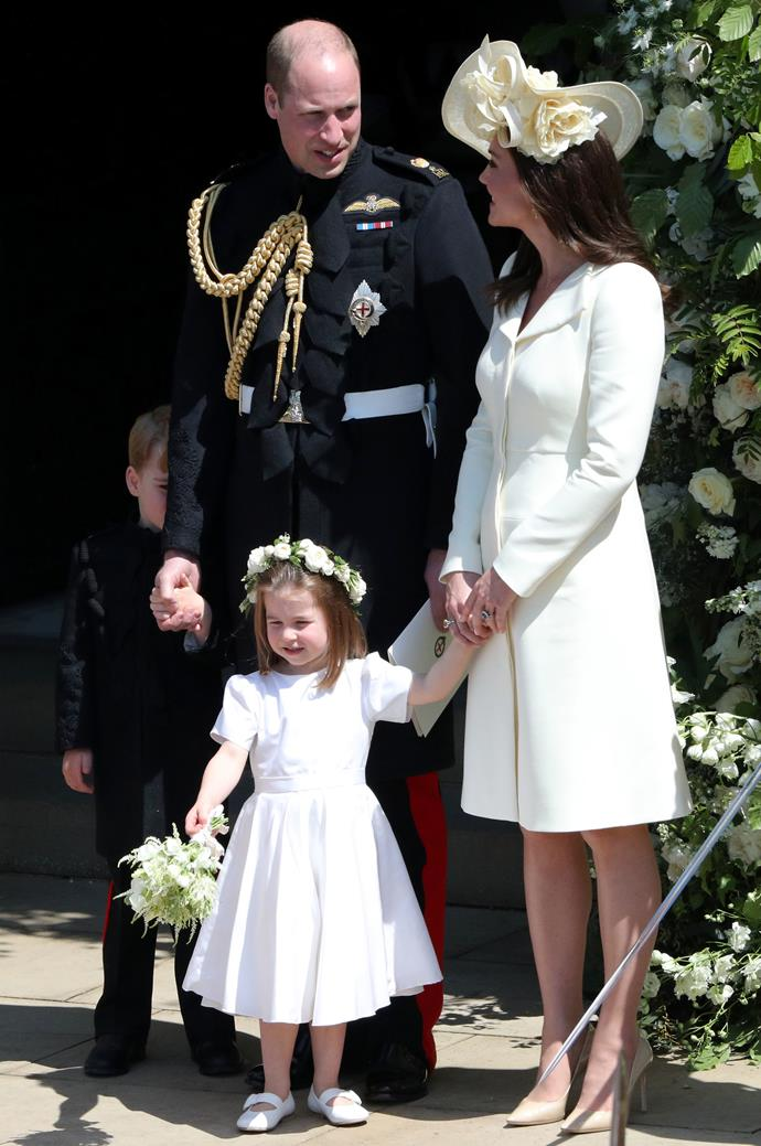 Prince George was very shy at Duchess Meghan and Prince Harry's wedding - look how adorable George is hiding behind his dad!