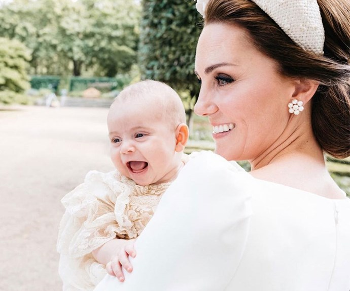 The royal family have released a candid christening photo of Prince Louis laughing