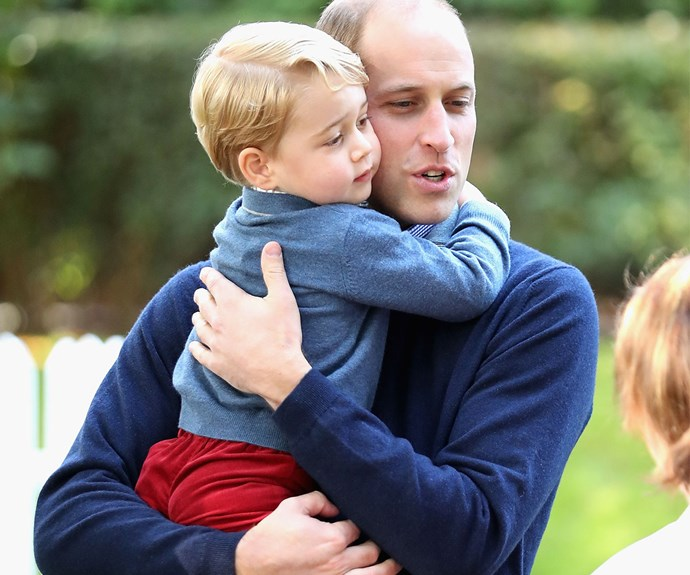 Some cuddles with dad seem to lift George's mood.