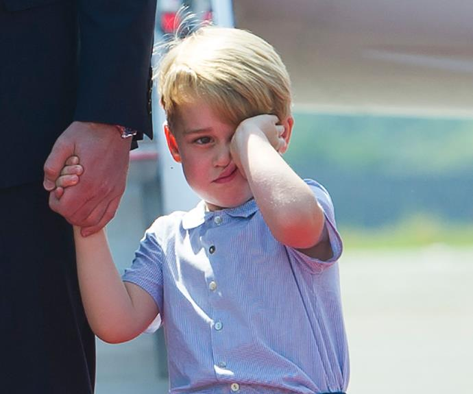 In true George style, the little prince looked tired and disinterested when the Cambridge clan arrived in Berlin.