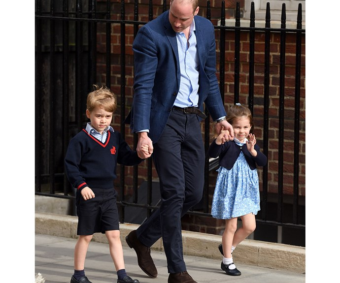 Prince George was wary of photographers as he walked with his dad and sister on their way to meet Prince Louis.