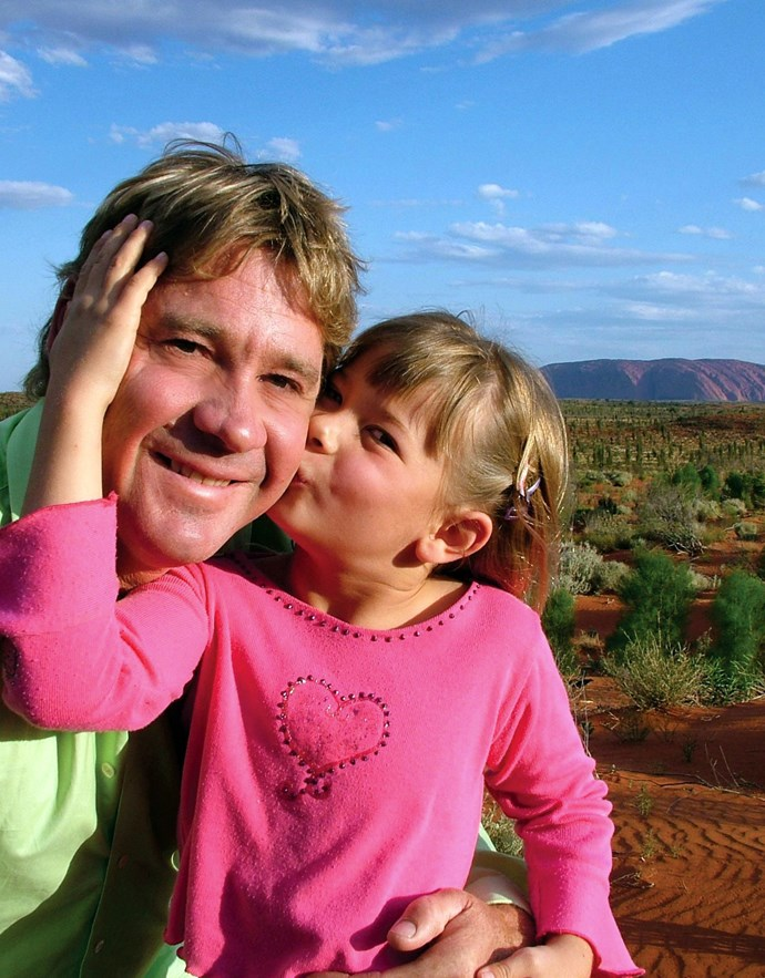 In earlier years: Bindi plants a kiss on her dad's cheek.