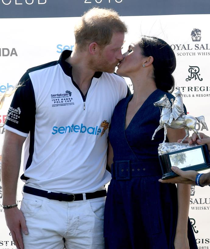 Prince Harry and Meghan Markle share a kiss at the Polo recently.