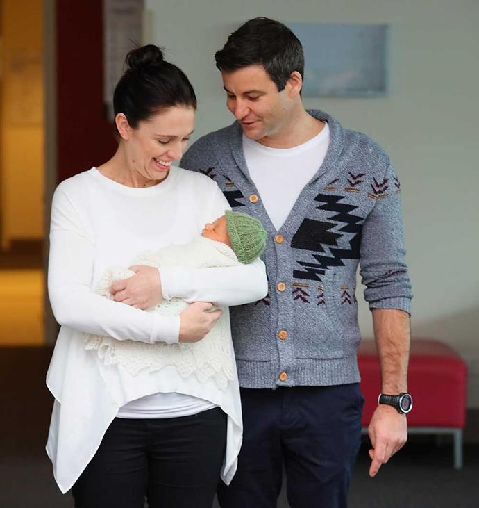 Jacinda and Clarke introduce their precious new bundle of joy to the waiting press.
