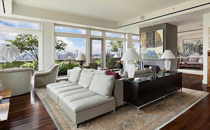 The open plan living area has numerous spots for relaxing.