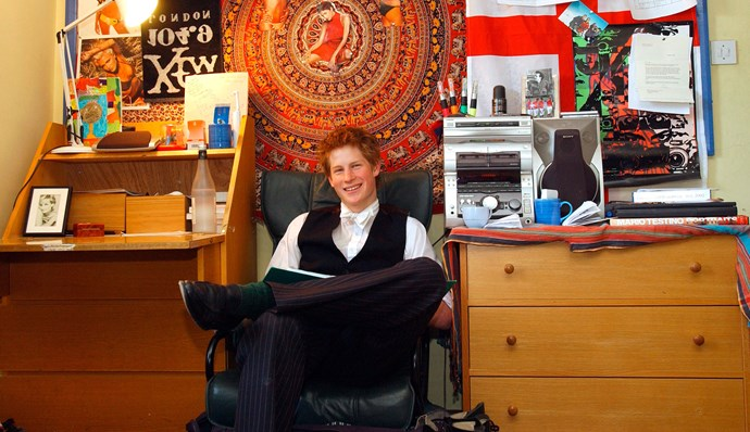 An 18-year-old Prince Harry in his Eton College room. Halle Berry takes pride of place in the wall above him.