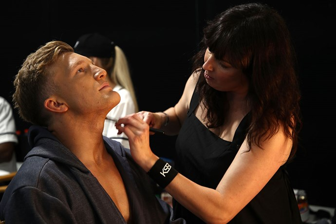 Damian McKenzie gets some final touch-ups backstage.