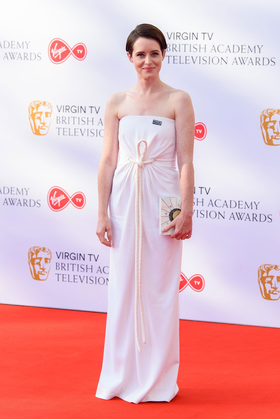 For the 2018 Britain Academy Television Awards Foy wore a white Rosetta Getty gown adorned with a Times Up sticker.