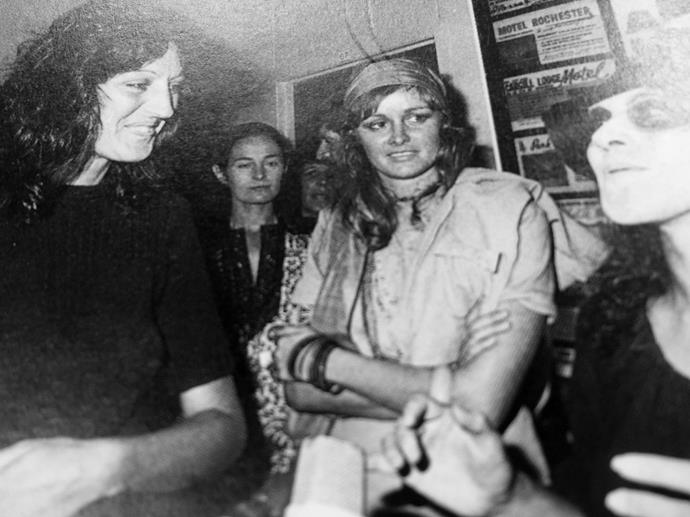 Sue meeting Germaine Greer at Auckland Airport on her visit to New Zealand, with Ngahuia Te Awekotuku dressed up as a witch in the foreground.