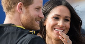 Prince Harry smooths down Duchess Meghan's hair for her when the wind catches it - could this pair be more adorable!
