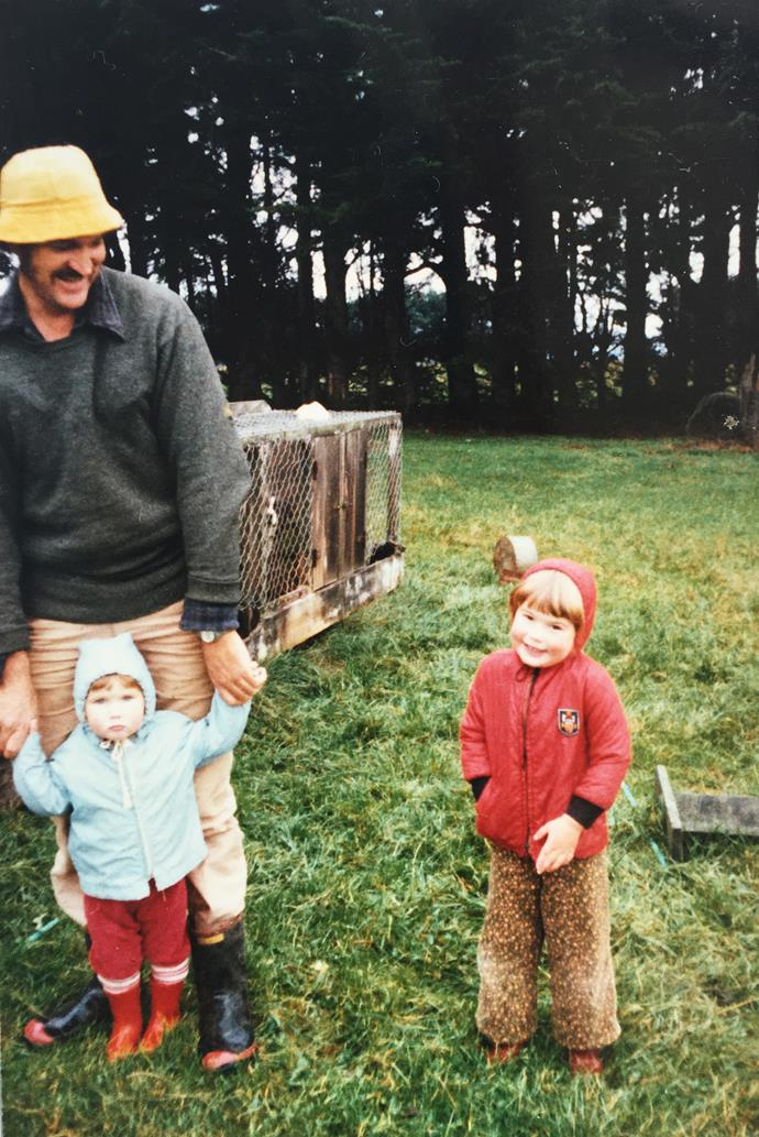 Fiona (in red jacket) and her sister with their father on the farm