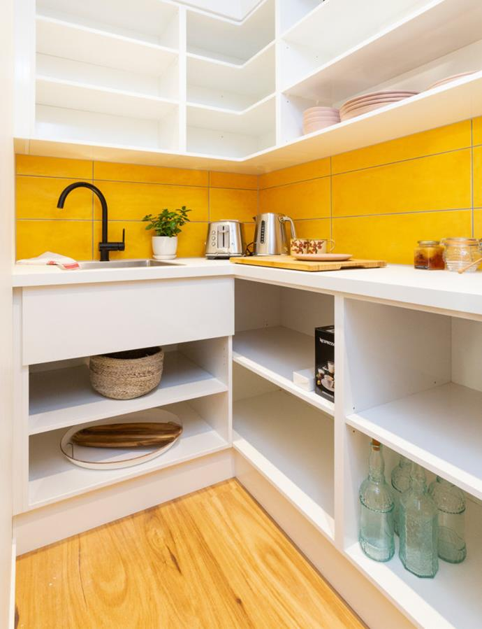 The sunshine yellow tiles also feature in the butlers pantry behind the kitchen.