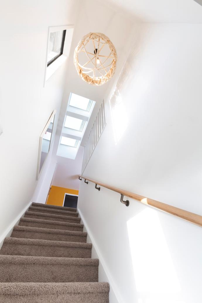 The stairwell leading up to the top floor has plenty of natural light thanks to the three skylights above it.