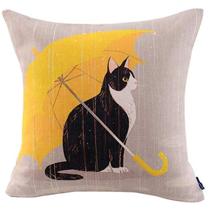 "This [cat cushion can be found on Amazon](https://www.amazon.com/JES-MEDIS-Decorative-Cushion-18x18inch/dp/B01NBEG8RK/ref=pd_sim_201_1?_encoding=UTF8&pd_rd_i=B01NBEG8RK&pd_rd_r=a7b9df9a-c51d-11e8-9084-47b0b2b8c51c&pd_rd_w=YSD6Q&pd_rd_wg=Ob5Mu&pf_rd_i=desktop-dp-sims&pf_rd_m=ATVPDKIKX0DER&pf_rd_p=56838e6b-66d4-41e0-a762-743f1a1a628a&pf_rd_r=QXBNK25MW98PS04DWGD9&pf_rd_s=desktop-dp-sims&pf_rd_t=40701&psc=1&refRID=QXBNK25MW98PS04DWGD9|target=""_blank""