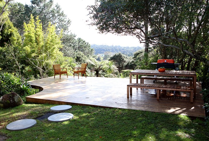 The garden deck has stunning views over the Waitakere ranges.