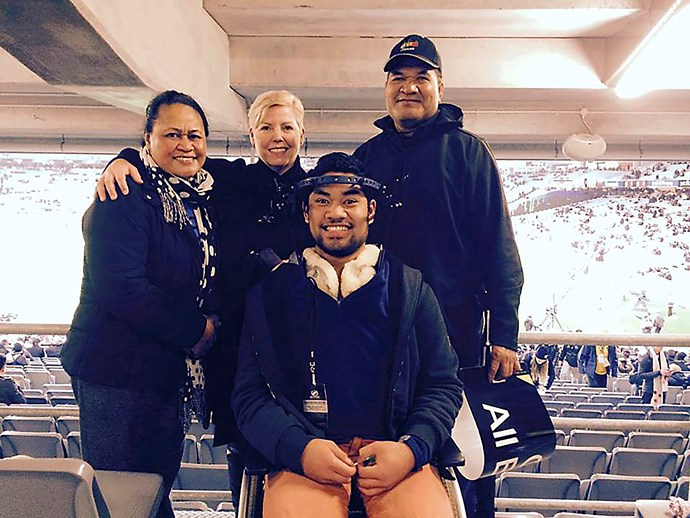 Lisa with Toia Laufili, who suffered a severe spinal injury playing rugby in 2015, and his parents.