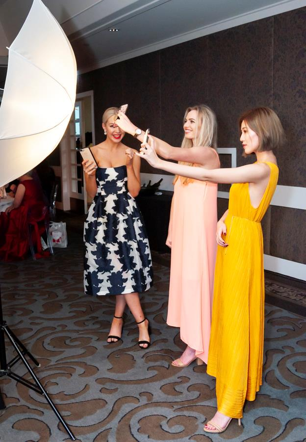 The Elizabeth Arden team finding their light for selfies.
