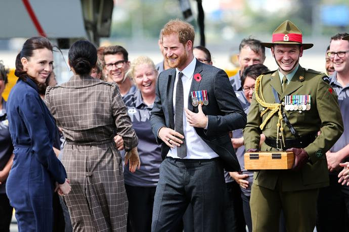 Prince Harry and Duchess Meghan both wore red poppies on their person.