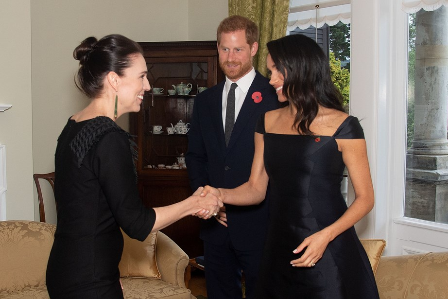 Prince Harry and Meghan greet New Zealand Prime Minister Jacinda Ardern during their visit to New Zealand last year. *(Image: Getty)*