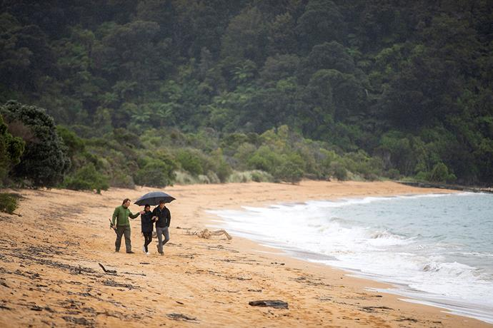 The pair took a walk on the beach with a ranger to discuss conservation issues.