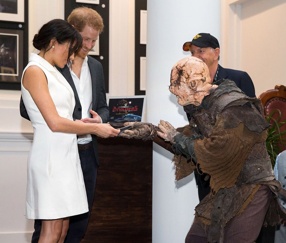 Meghan and Harry were presented with a necklace by an orc! *(Image: Getty)*