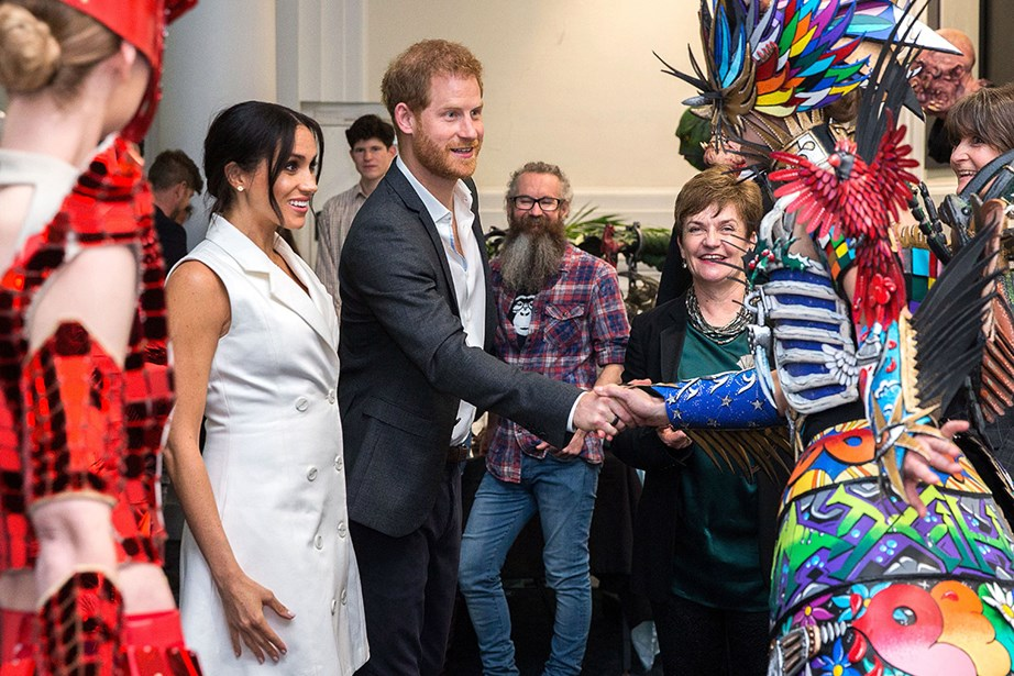 Meghan and Harry mingled with some impressive characters during their visit to Wellington's Courtney Creative. *(Image: Getty)*