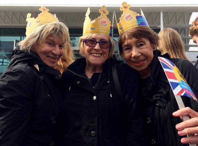 Genevieve Bakker, 83, (R) , Fay Simpson, 79, (C) and Verna Jamieson, 71 (L) weren't going to let a little rain get in the way of their chance to get a glimpse of Meghan and Harry.