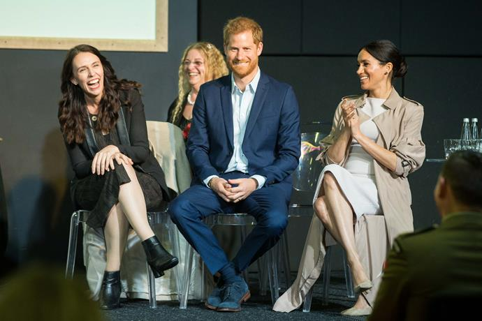The Duke and Duchess of Sussex sit with Prime Minister Jacinda while they are welcomed to Pillars.