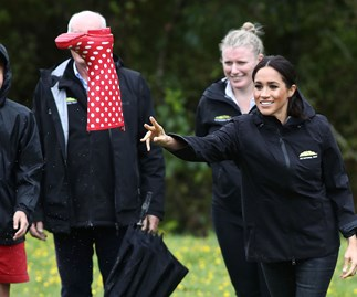 Duchess Meghan beats Prince Harry in a gumboot throwing competition at Redvale, Auckland