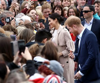 Duchess Meghan gets a blast from the past during a walkabout with Prince Harry at Auckland's Viaduct Harbour