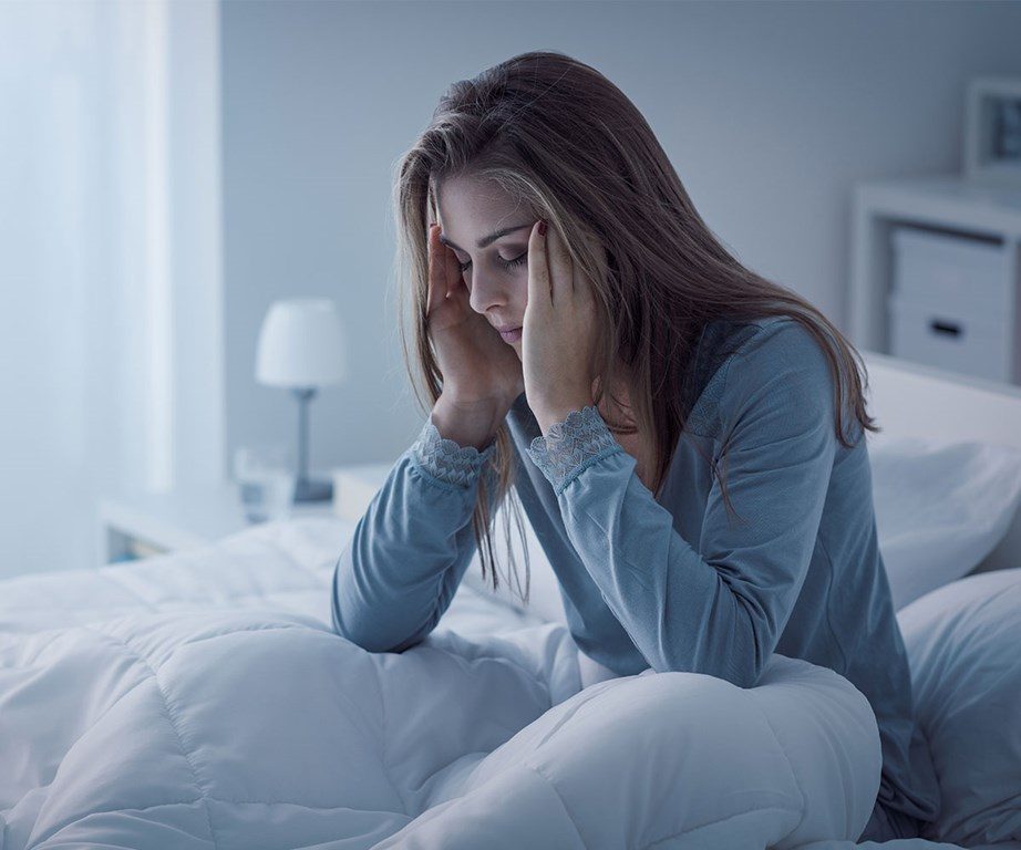 If you're struggling to go to sleep, get up and change your environment for a bit, Robbins suggest. It'll mean you won't start associating your bed with insomnia. *(Image: Getty)*