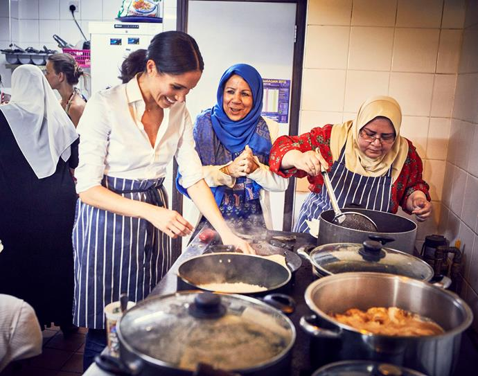 Meghan in the kitchen with survivors of the Grenfell fire.