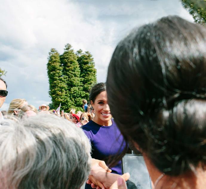 The moment Meghan shakes Stephanie's hand.