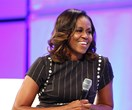 Michelle Obama reveals she conceived both daughters via IVF after suffering a miscarriage