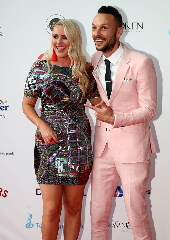 "Sharyn Casey and Ben Boyce made sure their outfits popped. It's not every man who can pull off a blush linen suit but Ben wears his Hallensteins ensemble well. Sharyn wore ""a vintage hire dress – they had to put a new zip in because I couldn't sit!"""