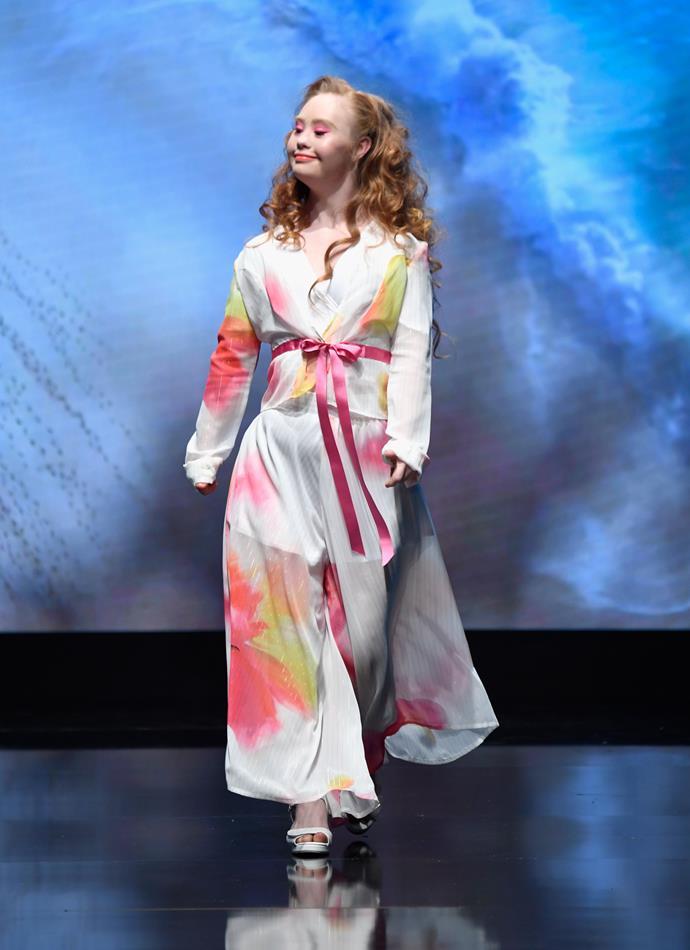 Madeline walks the runway wearing 21 Reasons Why at Los Angeles Fashion Week in October 2018.