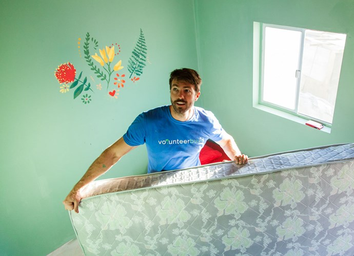 Art puts the finishing touches on the newly built home. *Photo: Emily Hlavac Green*