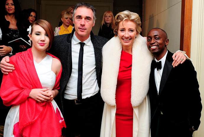 With husband Greg Wise, their daughter Gaia and adopted son Tindy
