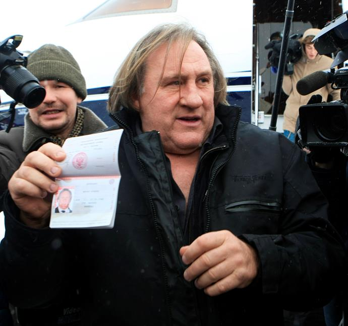 Gerard flaunts his new Russian passport,  decamping to Russia after a hissyfit over a tax bill.